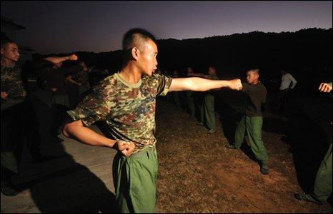 Kachin recruits start practicing martial arts before sunrise.