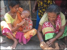 women making a clay pot