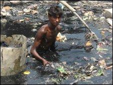 Man standing in putrid water