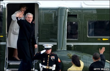 Former US President George W. Bush and Laura Bush wave from a helicopter