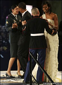 President Obama dances with Army Sgt Margaret Herrera and Michelle Obama dances with Marine Sgt Eliidio Guillen at the Commander-In-Chief's Inaugural Ball