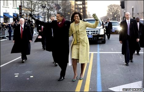 U.S. President Barack Obama and first lady Michelle Obama walk in the inaugural parade