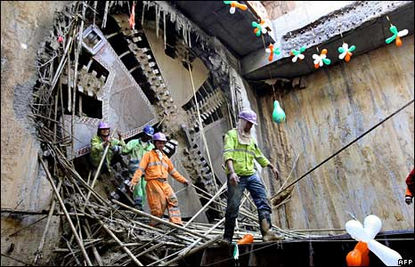 Workers emerge from a tunnel-boring machine in New Delhi, India