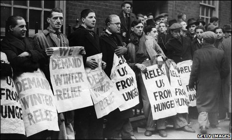 Unemployed men protest outside a Labour exchange in London during the Great Depression