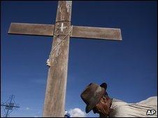 File photograph of a man praying at a tomb in El Alto, Bolivia