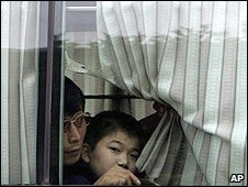 North Korean defectors look out from a bus taking them to Seoul (file image)