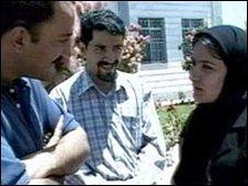 Dr Arash Alaei (left) and Dr Kamiar Alaei (centre) an Iranian woman with HIV patient