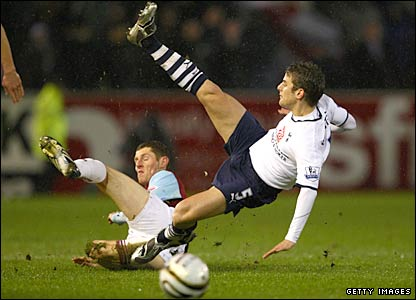 David Bentley is tackled by Chris McCann