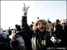 A large crowd watches the inauguration ceremony of President Barack Obama