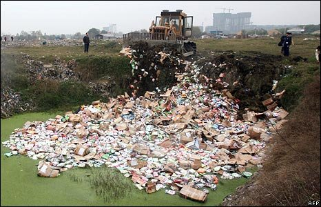 Chinese enforcement officers destroy a batch of tainted milk powder in Wuhan, Hubei province on 17 November 2008