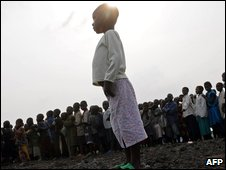 Children line up before starting school in a refugee camp near Goma
