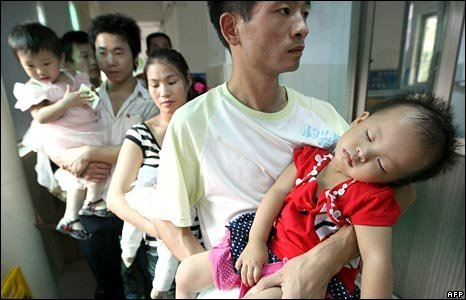 Parents wait for their children to be seen in hospital in Hangzhou, Zhejiang province