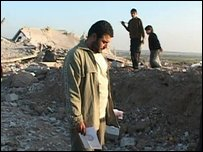 Khaled Abedrabou stands amid the rubble of his neighbourhood