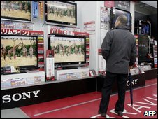 A customer in front of a Sony TV store, Tokyo
