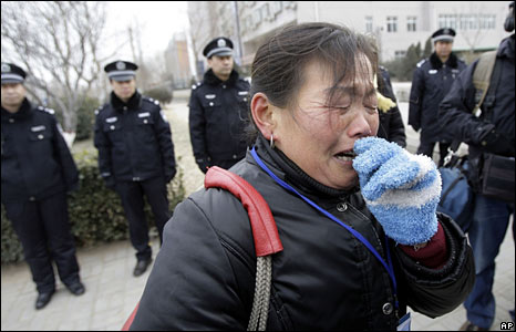 The grandmother of a baby who died after drinking tainted milk cries outside the court in Shijiazhuang, Hebei province, on 22 January 2009