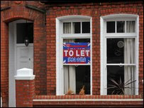 """To Let"" sign in a house window"