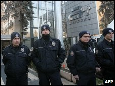 Turkish police outside the Ankara office of the private ART television station on 22/1/09