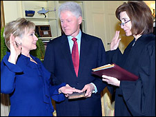 Hillary Clinton is sworn in as Secretary of State while her husband, former president Bill Clinton, holds the bible - 21/1/2009