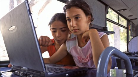 Children accessing the internet on a visiting bus