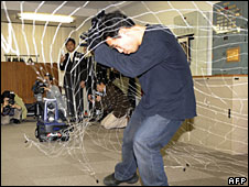 Prototype T-34 security robot throws a net during a demonstration in Tokyo, 22 January 2008