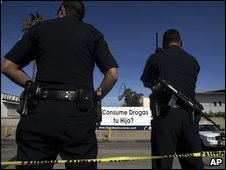 Police officers guard a crime scene where a woman was killed in Tijuana, 6 Jan 2009
