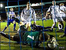 Ayr keeper Stephen Grindlay can't keep Simon Ford's header out