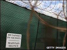 Sign on fence at Guantanamo Bay