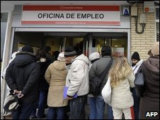 People queuing at a job centre in Madrid