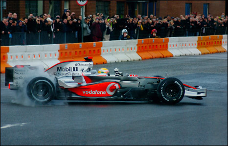 lewis hamilton car. Lewis Hamilton in racing car