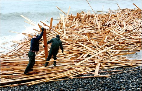 Men with timber on Ramsgate beach