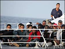 Italian officials rescue illegal immigrants off the coast of Lampedusa (file photo)