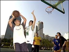 Youths playing basketball in Shanghai, China