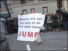 "Man holding a sign saying ""Bernie, it's not too late to do the right thing - JUMP"""
