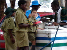 School children in Harare buying refreshments from a vendor (November 2004)