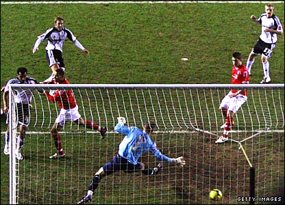 Rob Hulse (top left) fires his ninth goal of the season to give Derby a first-half lead