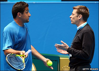 Nicolas Almagro (left) talks to the match referee