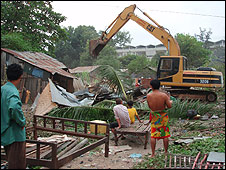 Residents watch bulldozers at work in Dey Krahorm