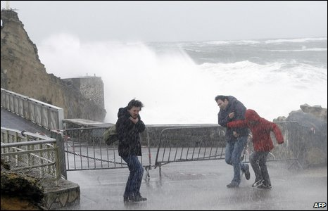 People walk under heavy rain in Biarritz, France, 24 January