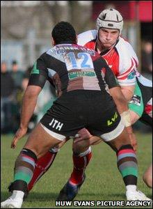 Scarlets centre Jon Davies finds his path blocked by Jordan Turner-Hall