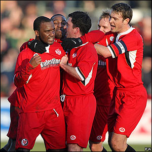 Kettering's Craig Westcarr is mobbed by his team-mates