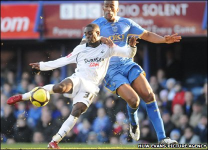 Nathan Dyer scores the Swans' opening goal in their fourth-round FA Cup clash at Portsmouth