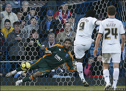 Swansea's Jason Scotland scores from the penalty spot