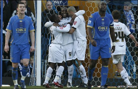 Jason Scotland celebrates putting Swansea 2-0 up against FA Cup holders Portsmouth