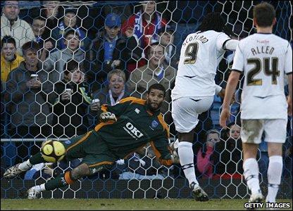 Jason Scotland sends his penalty past Portsmouth keeper David James