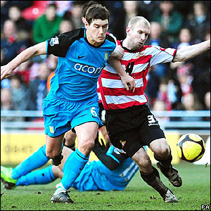 Gareth Barry tussles with Doncaster's Gareth Roberts
