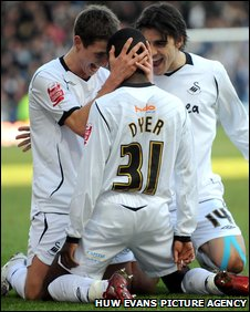 Nathan Dyer is congratulated by Joe Allen and Jordi Gomez after putting the Swans in front
