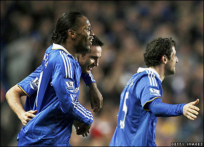 Chelsea's Frank Lampard is congratulated by his team-mates
