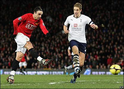 United's Dimitar Berbatov fires a stunning shot into the far corner of the net