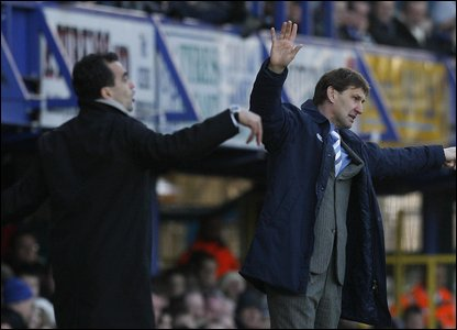 Are Swansea boss Roberto Martinez and Pompey boss Tony Adams having a flying competition? Looks like Adams is flapping