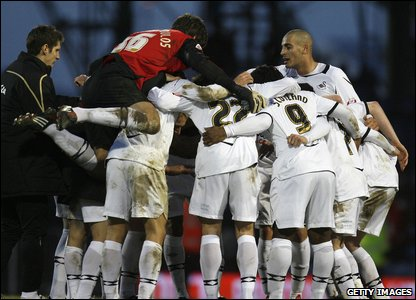 The final whistle goes and Swansea players celebrate their deserved win.